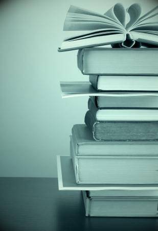Stack of books in dark green light Stock Photo - 18741208