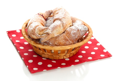 Taste croissants in basket isolated on white Stock Photo - 18741199