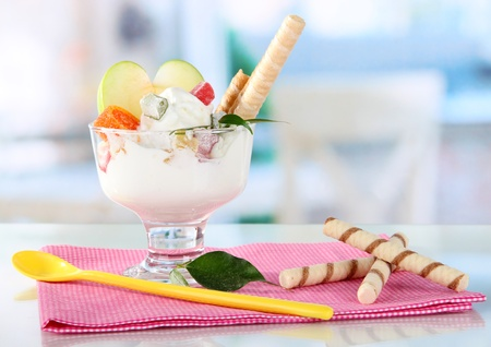 seemed: Ice cream with wafer sticks on napkin on window background