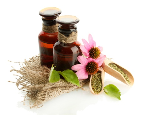 dried herb: medicine bottles with purple echinacea , isolated on white