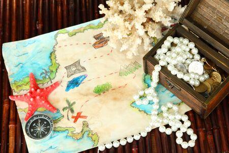 map of treasures on dark wooden background Stock Photo - 18775743