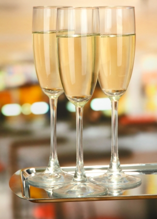 Corporate party: sparkling champagne glasses on tray photo