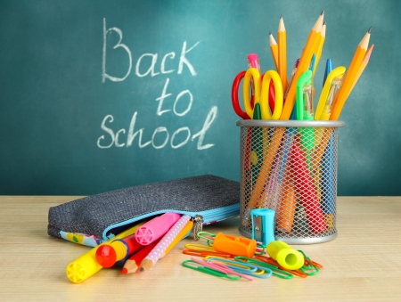 stationery set: Back to school - blackboard with pencil-box and school equipment on table Stock Photo