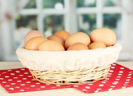 Many eggs in basket on table in room Stock Photo - 18774852