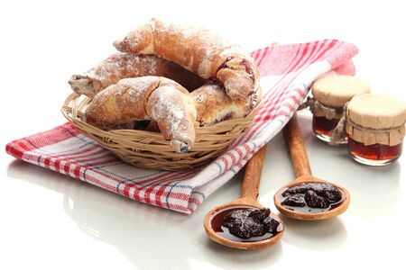 Taste croissants in basket and jam isolated on white Stock Photo - 18775565