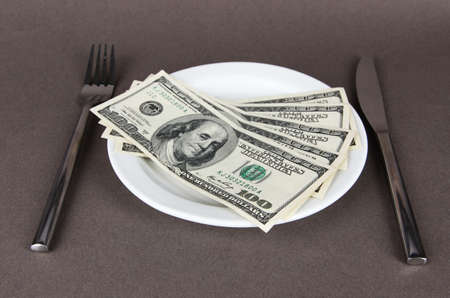 Money on plate on grey background photo