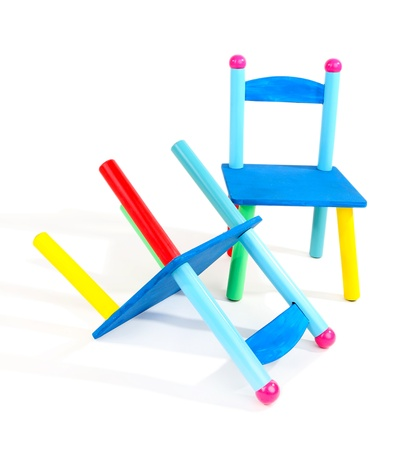 Small and colorful chairs for little kids isolated on white Stock Photo - 18772934