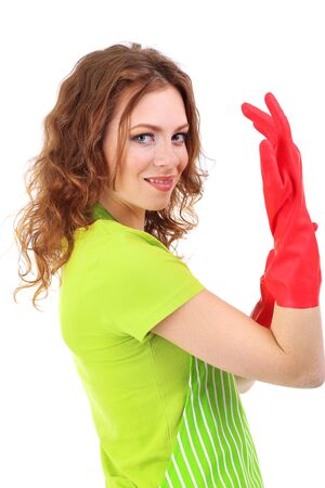 Young woman wearing green apron and rubber gloves, isolated on white photo