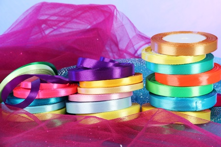 Bright ribbons on bright background photo