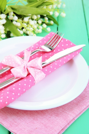 Table setting in white and pink tones on color  wooden background Stock Photo - 18816261