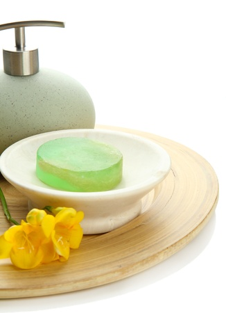 Bottle and soap-dish with soap isolated on white photo