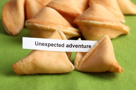 Fortune cookies on green tablecloth photo