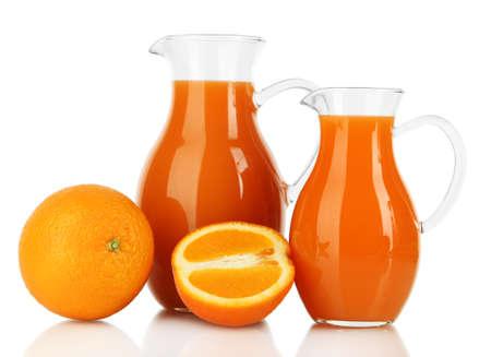 Orange juice in pitchers isolated on white photo