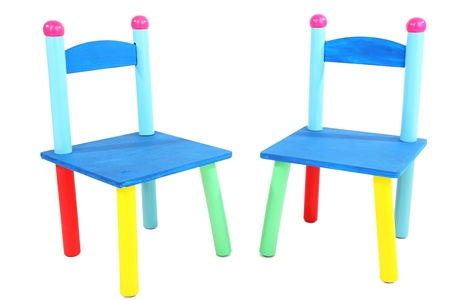 Small and colorful chairs for little kids isolated on white Stock Photo - 18818070