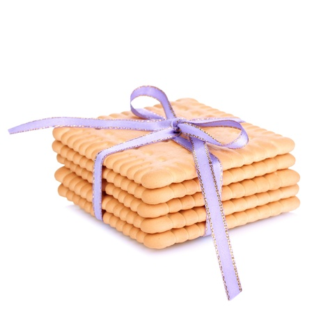 Sweet cookies tied with lilac ribbon isolated on white photo