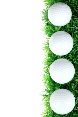 Golf balls on grass isolated on white photo