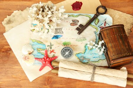 map of treasures on wooden background Stock Photo - 18835593