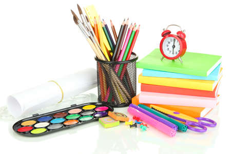 School supplies, books and clock isolated on white photo