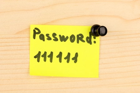Sticker-reminder with most popular password, on wooden background Stock Photo - 18839365