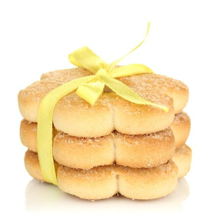 Sweet cookies tied with yellow ribbon isolated on white photo