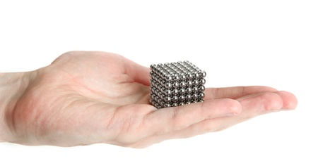 Neocube (toy) on man hand, isolated on white photo