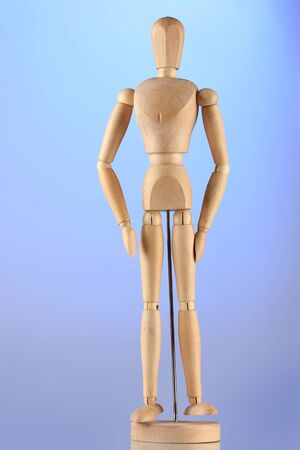 wooden mannequin, on blue background photo