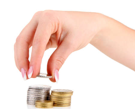 Woman hand with coins, isolated on white Stock Photo - 18890303