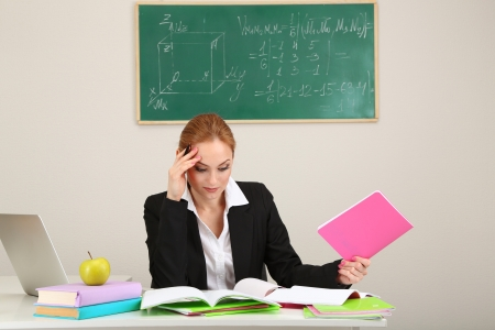 univercity: Portrait of teacher woman working in the classroom Stock Photo