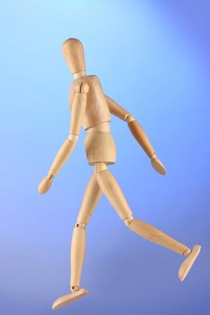 wooden mannequin, on blue background photo