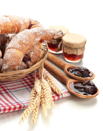 Taste croissants in basket and jam isolated on white Stock Photo - 18905734
