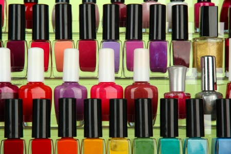 Bright nail polishes on shelf, close up photo