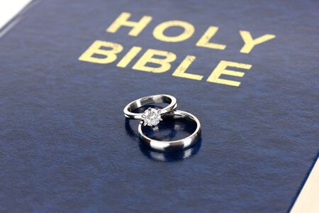 Wedding rings on bible photo