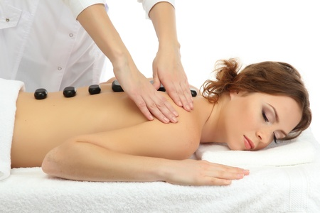 beautiful young woman in spa salon getting massage with spa stones Stock Photo - 21515567