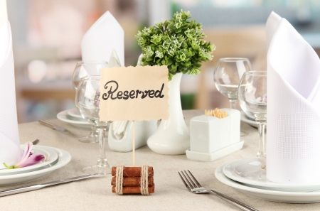 reserves: Reserved sign on restaurant table with empty dishes and glasses