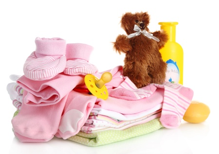Pile of baby clothes isolated on white photo