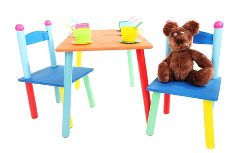 Small and colorful table and chairs for little kids isolated on white Stock Photo - 18940517