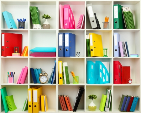 book racks: White office shelves with different stationery, close up