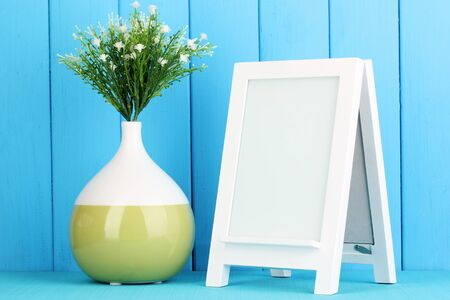 White photo frame for home decoration on blue background Stock Photo - 19037695