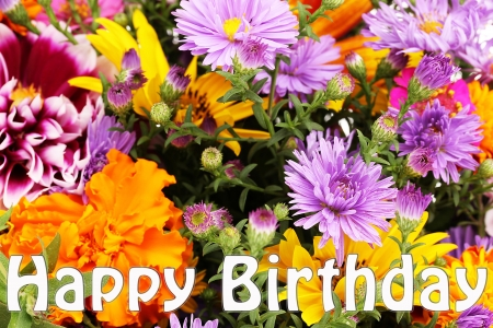 Beautiful bouquet of bright flowers close-up as b-day card photo
