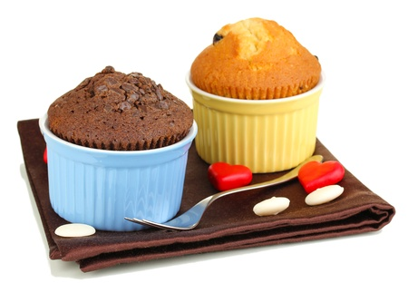 cup cakes: Cupcakes in bowls for baking isolated on white