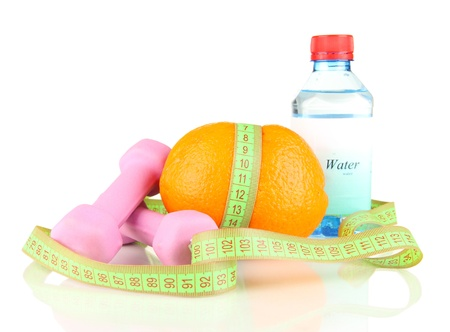 Orange with measuring tape, dumbbells and bottle of water, isolated on white photo