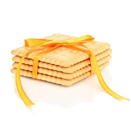 Sweet cookies tied with yellow ribbon isolated on white Stock Photo - 19040758
