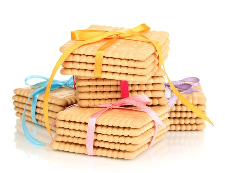 Sweet cookies tied with colorful ribbons isolated on white photo