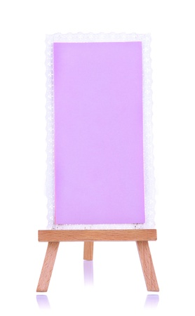Small easel with sheet of paper isolated on white Stock Photo - 19040799
