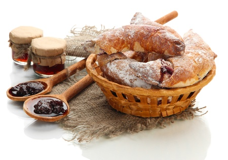 Taste croissants in basket and jam isolated on white  photo