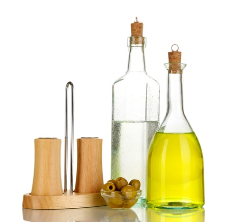 stopper: Original glass bottles with salad dressing isolated on white