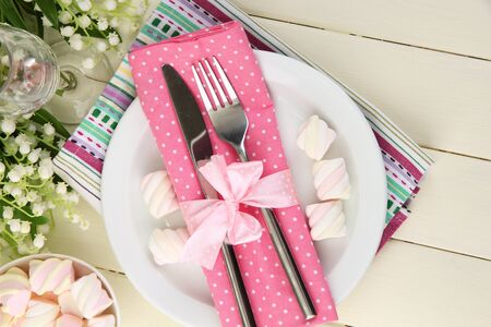 Table setting in white and pink tones on color  wooden background Stock Photo - 19056309