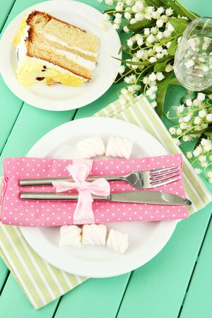 Table setting in white and pink tones on color  wooden background Stock Photo - 19056311