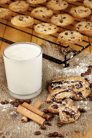 Chocolate cookies on the baking with glass of milk close up photo