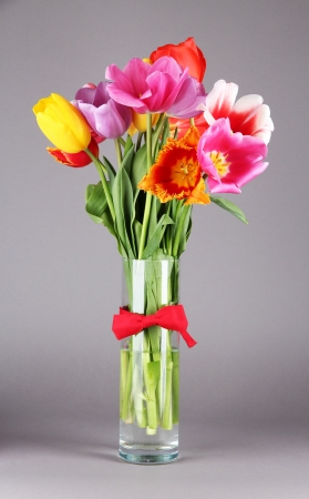 flower bouquet: Beautiful tulips in bouquet on gray background